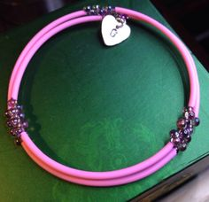 Memory wire bracelet with beads and charm and by HarmoniousHearts, $18.00