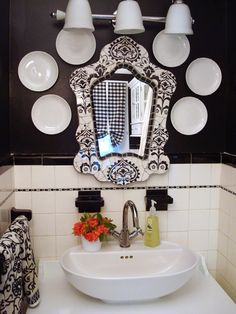 Merge Style With Two Hues:  You don't need to stick to just one common color. Add a bit more interest to the mix with a color combo. This original 1930s black and white tiled bathroom got a mix of modern thrown in with high gloss black paint on the walls and a new white bowl sink. Photo courtesy of Camila Pavone.