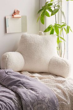 Streaming from your bed? A backrest will keep you from getting a crick in your neck.Urban Outfitters Shearling Boo Pillow, $129, available at Urban Outfitters.  #refinery29 http://www.refinery29.com/netflix-and-chill-products#slide-9