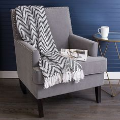 Chevron Fringe Throw Blanket In Blue - Get cozy on your sofa with the luxurious Chevron Fringe Throw Blanket. With a textured pattern and fringe edges, this soft blanket keeps you warm while adding a stylish touch when draped across the back of the couch. Grey Throw Blanket, Couch Blanket, Wingback Chair, Sofa, Soft Blankets, Getting Cozy, Furniture, Warm, Chevron
