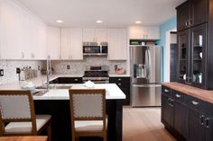 Dark lower cabinets and light upper cabinets create a unique look while still using store-bought cabinetry.