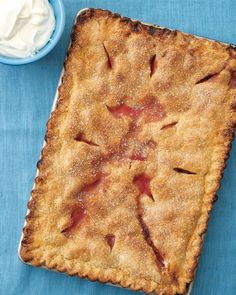 Strawberry-Rhubarb Slab Pie Recipe. This pie is great on its own -- but sublime with a dollop of fresh whipped cream.