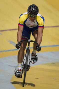 Track cycling sprinter Hersony Canelon rides during a practice session in Caracas, May 23, 2012.
