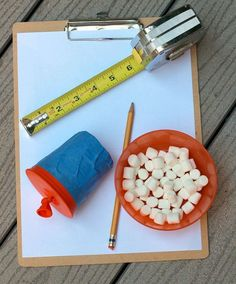 marshmallow shoot and measure....kids learn measurements while playing with marshmallows or pom poms....what could be better