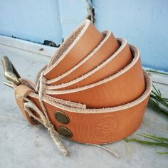 Part of the Legacy Series, this belt is designed to be with you through the years as you build your personal legacy.~Made with legendary Hermann Oak USA tanned leather in and out ~Oiled and suntanned in the Arizona sunshine, then hand buffed to a beautiful golden tan color with mild luster. ~Color and patina will continue to develop and change with time and use. ~Compliments any wardrobe or style, matching products include Raw Belt Loops and Wallets***made to order, sh...
