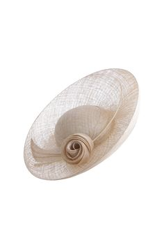 1950's inspired saucer millinery by a British milliner Beautiful Pinokpok is crafted into a wonderful sculptural saucer style hat. Commissioned in bespoke colours from the Suzannah boutique..x