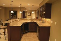wet bar with granite counter, mosaic tile back splash in basement finish | Yelp