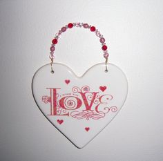 With thick chipboard instead of ceramic, and then beaded wire to hang it. - Ceramic heart plaque I Wish You Love by MoanasUniqueDesigns