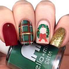 christmas theme decorations on each nail, different color nails, red green and gold glitter nail polish, wreath decoration on ring finger Cute Christmas Nails, Xmas Nails, Christmas Nail Art Designs, Holiday Nails, Red Nails, Hair And Nails, Cute Acrylic Nails, Cute Nails, Pretty Nails
