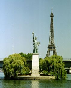 Statue of Liberty in Paris France dedicated July 5, 1889, Eiffel Tower in background