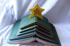 Learn to make this vintage book Christmas tree from old books. Such a fun piece to add to your holiday decor! Christmas Tree Made Of Books, Diy Christmas Tree, Handmade Christmas, Christmas Tree Decorations, Christmas Holidays, Christmas Ideas, Xmas Trees, Christmas Goodies, Merry Christmas