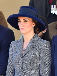 The Duchess accessorised witth a matching pear-shaped tanzanite and diamond necklace and e...