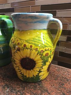 Rolling hills of brilliant yellow sunflower fields are the motif that grace this pitcher that is a practical work of art. You will never want to store away as it is a joy keep this pretty pitcher out for display. inches tall 7 inches wide at handle lbs. Sunflower Fields, Yellow Sunflower, Original Paintings, Vibrant, Hand Painted, Vase, Display, Unique Jewelry, Handmade Gifts