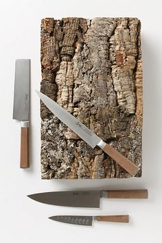 "WOW! Worthy of the most epic tree house habitat, this craggy bark case holds a set of stainless steel cork-handled cooking knives.  Set of four knives included:  Stainless steel, cork  Hand wash  Vegetable knife: 4.75""L  Usuba knife: 6.75""L  Chef's knife: 8""L  Bread knife: 8""L  Made in Portugal $398"