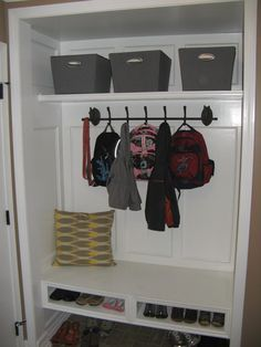 Closet conversion into mudroom.  Floating bench= shoe storage underneath