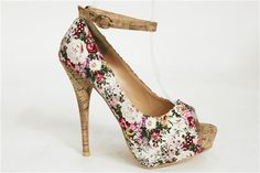 Floral heels with ankle strap.