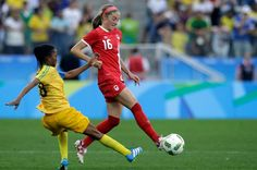 Canada's Janine Beckie controls the ball past Zimbabwe's Rejoice Kapfumvuti during a group B match of the women's Olympic football tournament between Canada and Zimbabwe in Sao Paulo, Brazil, Saturday, Aug. 6, 2016. (AP Photo/Nelson Antoine)