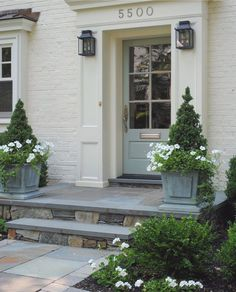 I love curb appeal projects! For Susan's beautiful home, I added lanterns from McLean Lighting, and selected Farrow and Ball Blue Gray 91 for the front door. Planters are from Restoration Hardware (entrance step curb appeal) Front Door Steps, Front Door Porch, Porch Steps, Front Door Entrance, Exterior Front Doors, Front Door Colors, Front Entrances, House Entrance, Colonial Front Door