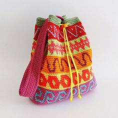 Crochet pattern for color block drawstring bag. Extra instructions to turn into a kids backpack. Charts, written instructions,photo tutorial