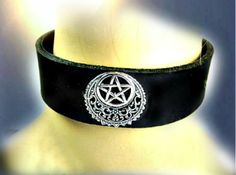 Pentacle Crescent Leather Choker Black Pink Brown Blue Silver filigree crescent surrounds a silver metal pentacle, forming a stand out focal piece for this leather choker. Choker is 1.25 inches wide and 12 inches long and has leather ties. Inside wiring is covered with felt for your comfort. Fits 13 to 16 inches.  #Pentacle #Crescent #LeatherChoker #BlackLeather