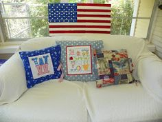 """patriotic pillows  """"W"""" from Hang to Dry  embroidery from Twin Stitchers"""