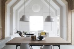 Ilse Crawford's cork-topped table from the Sinnerlig collection for Ikea and hanging Levels Lamps by Form Us With Love—in Forstberg Ling's House for Mother, Sweden