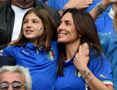 Elisabetta Muscarello (R), wife of Antonio Conte head coach of Italy, and Vittoria Conte, daughter of Antonio Conte, smile in the stand prior to the UEFA EURO 2016 round of 16 match between Italy and Spain at Stade de France on June 27, 2016 in Paris, France.