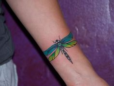 Nice Color Dragonfly Tattoo On Wrist