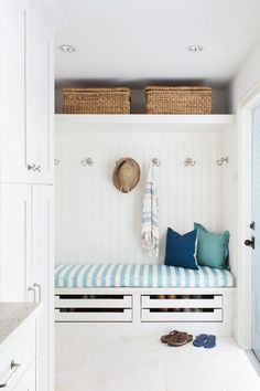coastal mudroom with shoe drawers