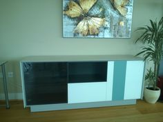 Sideboard from our Book range with frame in ceramic and glass fronts in white, turquoise and smoked glass. Many more variations possible. Delivered to one of our London clients.