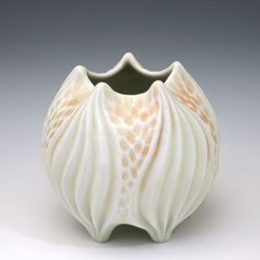 Carved porcelain yellow and orange squat vase by robertapolfus