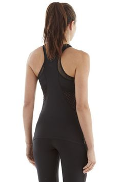 Michi Galvanize Black Top - A great racer style back will keep everything supported and covered, while the small mesh cutouts at the back are perfect for ventilation and to bring emphasis to your beautiful neck and back. This Michi tank top is one of the best eight way stretch options you'll find in the slimming black that isn't loud or show off too much skin. For those who love Michi Activewear top options, but find some of them too revealing or bright, this is a top for you. #michi