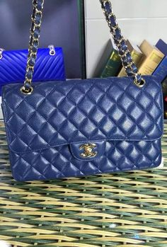 Chanel Small Classic Flap Bag in Dark Blue Caviar Leather with golden hardware sale at USD 309.  Free Shipping by courier to your address. Learn more on http://www.luxtime.su/chanel-bags