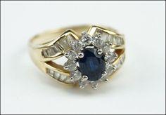 A DIAMOND, SAPPHIRE, AND 14 KARAT YELLOW GOLD RING. Lot 150-7211 #jewelry