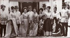 Filipino women in the traditional baro't saya with butterfly sleeves and overskirt, Filipino men in barong Tagalog by krystal Traditional Fashion, Traditional Outfits, Barong Tagalog, Eyes Looking Down, Philippines Fashion, Philippines Culture, Filipiniana Dress, Filipino Fashion, Filipino Culture