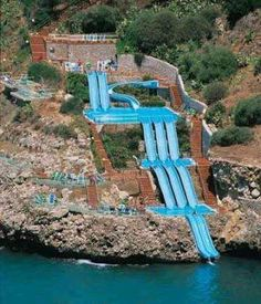 ITALY – Water slide into the Tyrrhenian Sea at the Città del Mare Hotel Village, metropolitan area of Palermo, island of Sicily. It's located on the Città del Mare road off of Strade Statali (state road) outside of the town of Terrasini. Vacation Places, Vacation Destinations, Dream Vacations, Vacation Spots, Places To Travel, Places To See, Vacation Ideas, Italy Vacation, Sicily Hotels