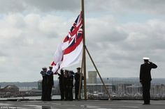 HMS Illustrious company members lower the ship's White Ensign for the final time at the ceremony today Military News, Navy Military, Hms Illustrious, Royal Navy Aircraft Carriers, Navy Day, Royal Marines, Navy Ships, Made In Uk, Troops