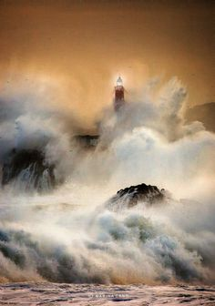 Spain. Mouro Island, Santander, Cantabria // by Marina Cano lighthouse bombarded by giant waves