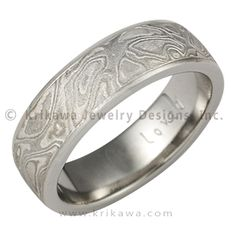 Platinum Mokume Gane Wedding Band with Light Etch - This mokume gane is made up of layers of three different metals: platinum, sterling and 14k palladium white gold. This extremely low contrast mokume needs to have an etch to best accentuate the contrast of colors of the metals. Our most subtle mokume for your wedding band. If you like a rugged look, but prefer a limited color contrast, the heavy etched Platinum Mokume Gane wedding band may be just for you. You will still have the woodgrain…