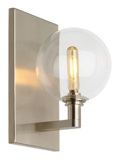 The Gambit Single LED wall sconce light from Tech Lighting exudes undeniable beauty and warm contemporary style through its bold use of high end mixed materials and retro-inspired, fully dimmable LED lamping.  This broadly appealing contemporary design is offered in two sizes, the petite 1-lite and scalable 3-lite, each with its own unique silhouette. Both sizes offer a convergence of contrasting elements including hard lines from their elegantly plated metal hardware and soft curves from…