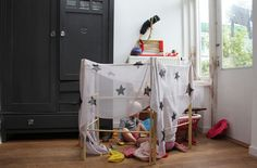 Fort made from drying rack and scarf: house of hink