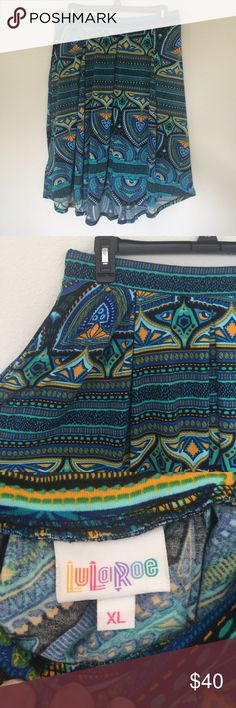 Beautiful Lularoe Madison Gorgeous Madison skirt by Lularoe. Beautiful pattern, flattering pleats and pockets! Can be worn high wasted, reaches almost to knee length. Worn a couple times, still in perfect condition. No pilling, stains or imperfections. LuLaRoe Skirts