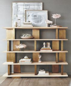 These grand and modern shelves from Roost marry brass blocks with sand-blasted elm wood for a handsome finish with ultimate function. The shelving has ample display space and a unique configuration th