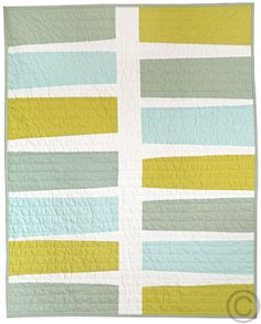 KAH says: quirky colors and a simple modern pattern. The straight line quilting is fantastic.