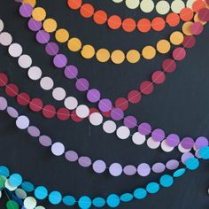 A super simple tutorial for DIY sewn paper garlands. Color coordinate them with the them of your next party!
