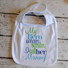 My Hero wears scrubs. I call her Mommy. Embroidered Bib on Etsy, $8.00