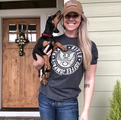 Black Rifle Coffee Company - Rocking our COTUS tee in style with a doggo on hip! We have sweet shirts & Merch! Tag your pictures for a chance to be shared! @sarahdamnyell #BlackRifleCoffee #AmericasCoffee