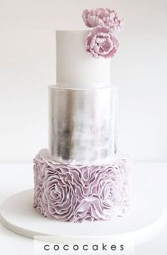We love the floral ruffles on the third tier but the second tier really makes the cake POP | Quinceañera Cake Inspiration