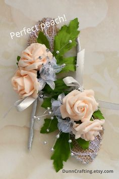 These peach and grey rosebud boutonnieres are just what you need, for the groom and his groomsmen.  Real touch roses, grey silk baby's breath, backed by a lacy hessian (leaf) for that rustic touch Blush Wedding Theme, Rustic Wedding Flowers, Rustic Boutonniere, Boutonnieres, Flower Girl Headbands, Wedding Flower Inspiration, Baby's Breath, Hessian, Bridesmaid Flowers