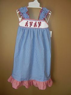 Cute Red/White/Blue Smocked Dress with Lobster applique. Log on to www.annieks.com to see similar items.